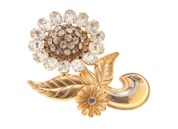 A brooch by Cocotay Social.
