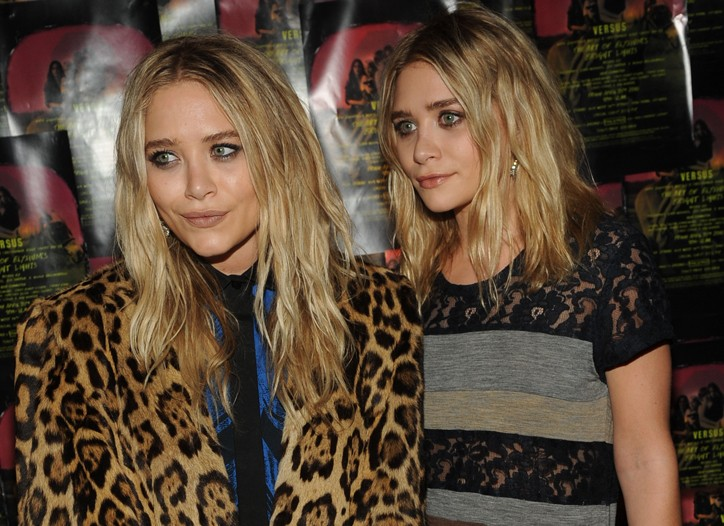 Mary-Kate in a Proenza Schouler dress and vintage jacket and Ashley Olsen in a vintage Comme des Garçons dress and The Row jacket.