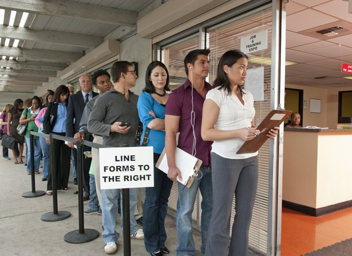 People standing in line at a job and training fair.