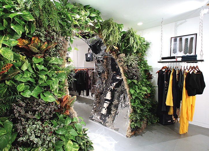 The living wall frames the entrance to the showroom.