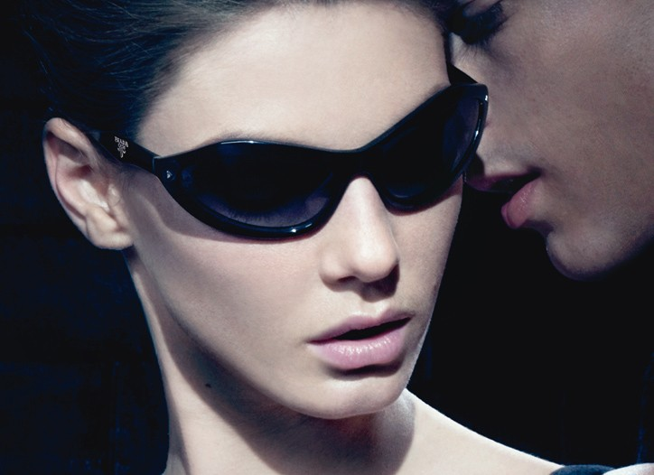 Ad for Prada Swing Sunglasses by Luxottica.