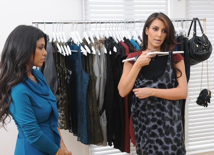 Kourtney and Kim Kardashian going through their new line for QVC, K-Dash by Kardashian.