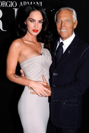 Armani with Megan Fox at the Giorgio Armani Privé show in July.