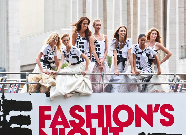 The models on top of a Fashion's Night Out double-decker bus.