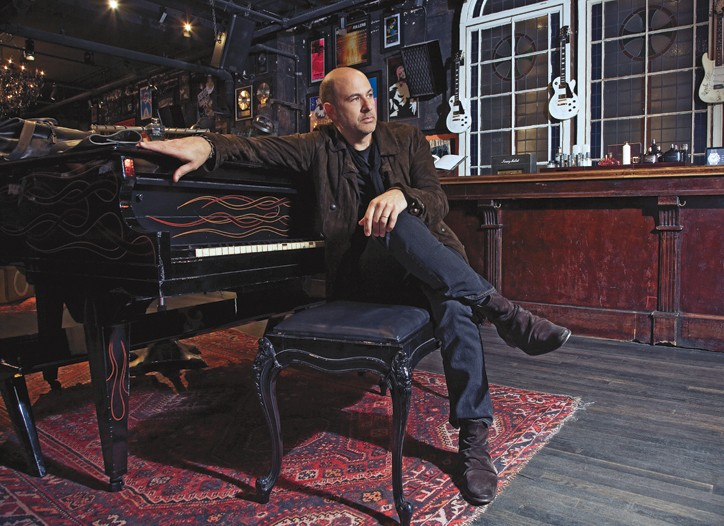 John Varvatos surrounded by music mementos in his New York office.