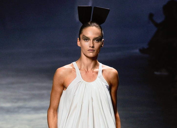 Rick Owens' fluid silk and cotton dress, shown with hair topped by a horn comb.