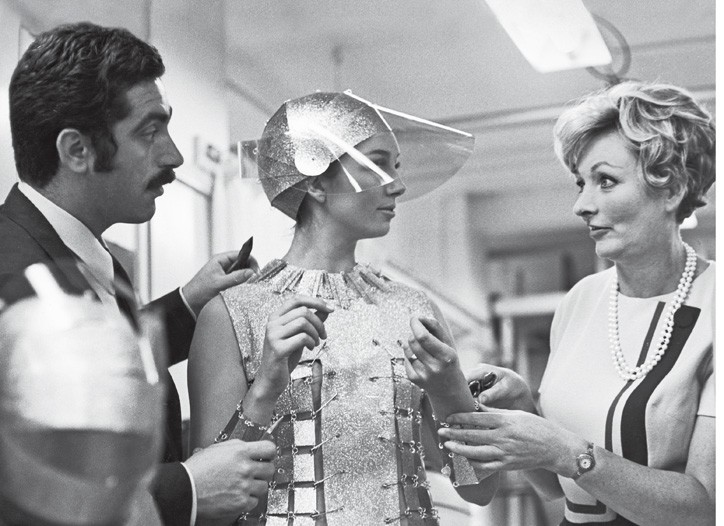 Paco Rabanne and Julie Harris discuss a Casino Royale costume in 1966.