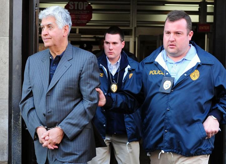 Ralph Esmerian being taken into custody Monday.