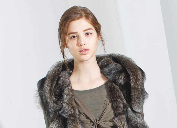 Donna Karan's long haired shearling hooded vest, garment dyed stretch viscose parachute dress over a wool crepe gauze jersey t-shirt.