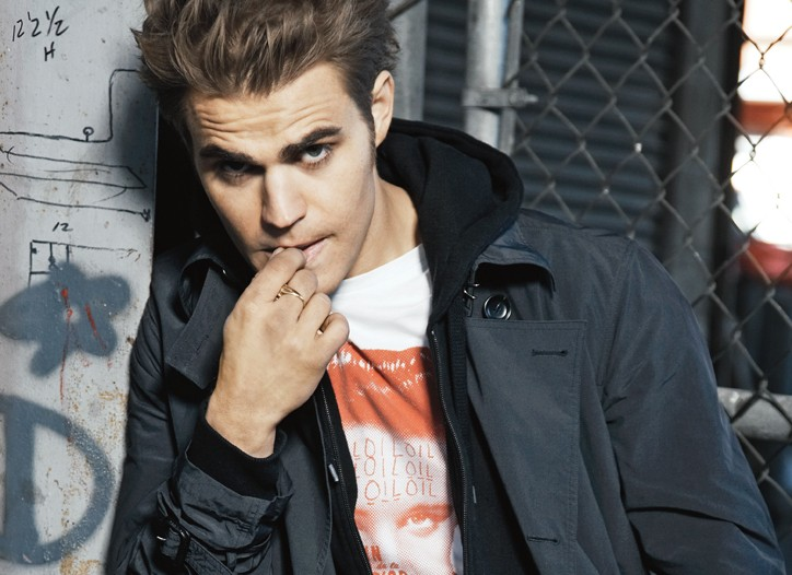 Paul Wesley wears Z Zegna's trench, Surface To Air's T-shirt, Y-3's cotton hoodie and Maison Martin Margiela's denim jeans, all in cotton.