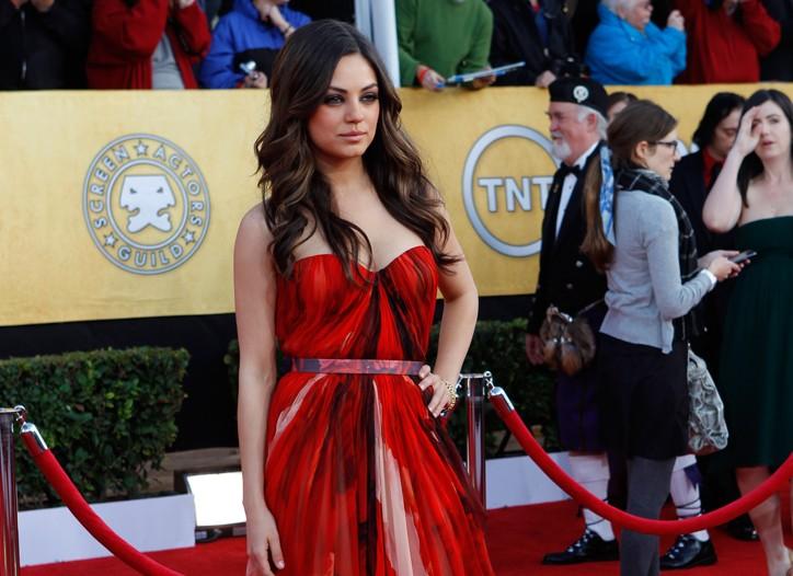Mila Kunis in Alexander McQueen and Cartier