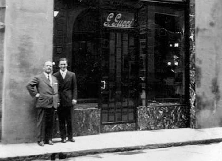 Guccio and Rodolfo Gucci in front of the Rome store, 1938.
