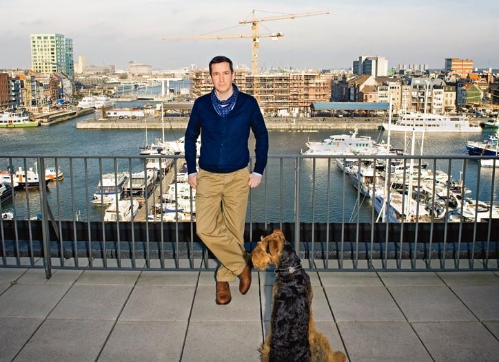 Dries Van Noten and his dog, Harry, on the rooftop of his Antwerp headquarters.