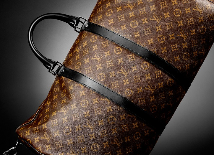 Louis Vuitton's Keepall 55 with shoulder strap.