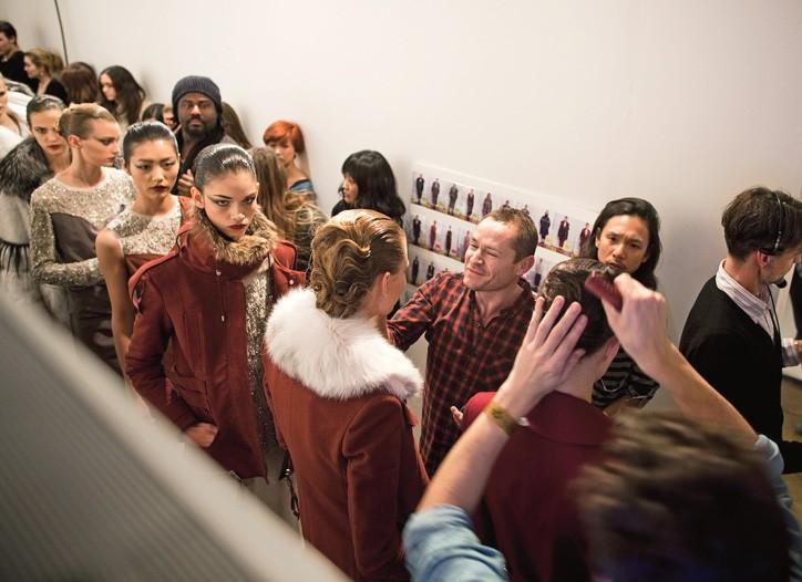 2.12.11: Pecheux touches up the models before Joseph Altuzarra's show.