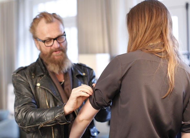 Johan Lindeberg working on a garment.