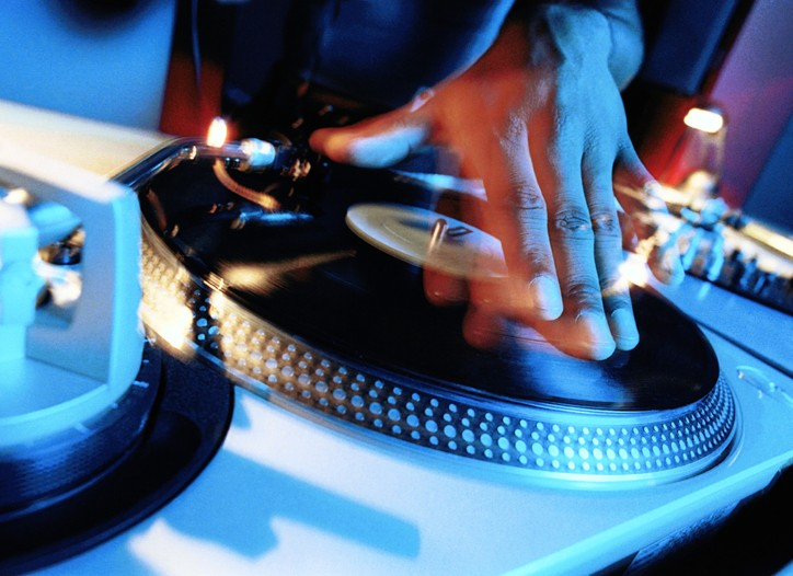 A DJ on a turntable.