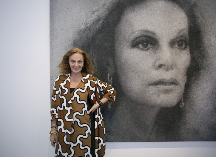 Diane von Furstenberg poses in front of an artwork by Zhang Huan.
