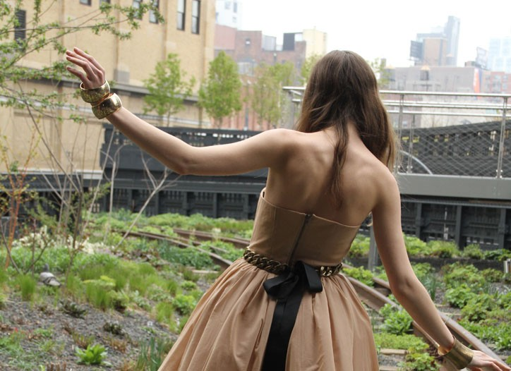Allison Parris' recycled polyethylene dress and acrylic chain and cotton belt. Vegetarian Shoes microfiber boots, A.D.O. cuff and bangles made of reclaimed metals.