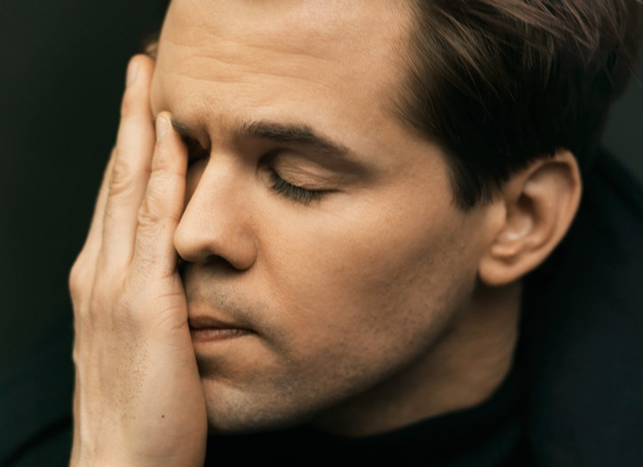 Andrew Rannells' in a Dolce & Gabbana coat and Armani Collezioni turtleneck, both in wool.