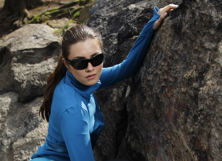 Moving Comfort's polyester and spandex pullover with thumb holes, and leggings trimmed with reflective safety detailing. Native Eyewear sunglasses; Black Diamond Equipment harness and carabiners;  Puma sneakers.