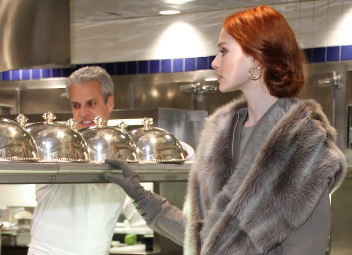 At Le Bernardin with chef Eric Ripert, Donna Karan's rayon and spandex jacket and pencil skirt, shearling stole, suede gloves, haircalf booties and cashmere tights. Vintage Cartier earrings.