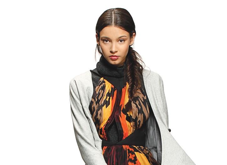 L.A.M.B.'s silk dress; Porter Grey's wool tweed dress (worn as jacket) and Line Knitwear's cashmere turtleneck. Anndra Neen bracelet; Matt Bernson boots.