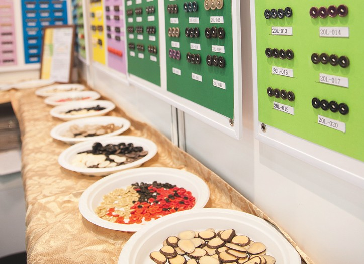 An array of buttons at Interstoff Asia.