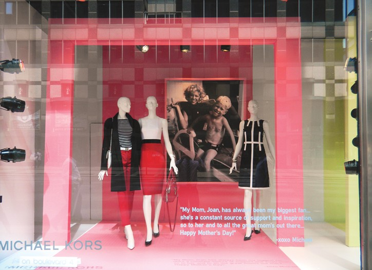 A photo of Michael Kors and his mother in Bloomingdale's window.