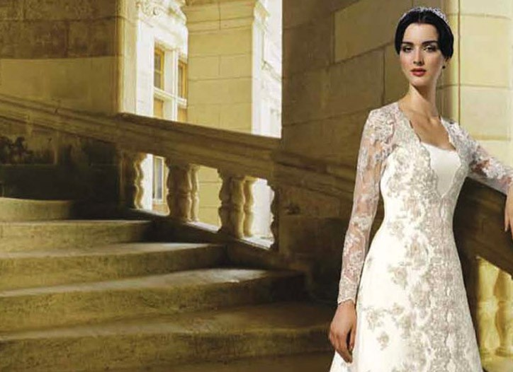 Oleg Cassini offered this gown with lace sleeves before Friday's royal wedding.