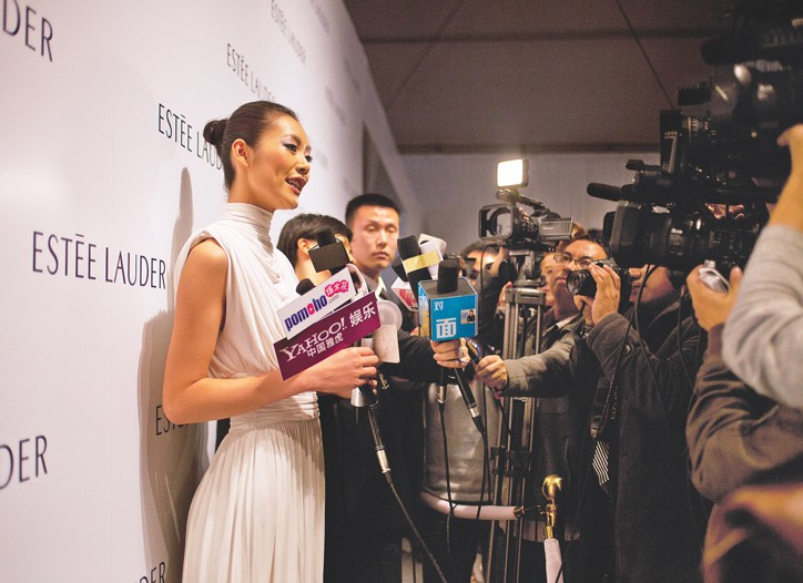 Model Liu Wen at a press conference in China.