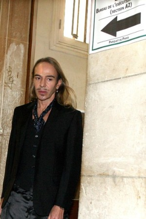 John Galliano arrives at court in Paris.
