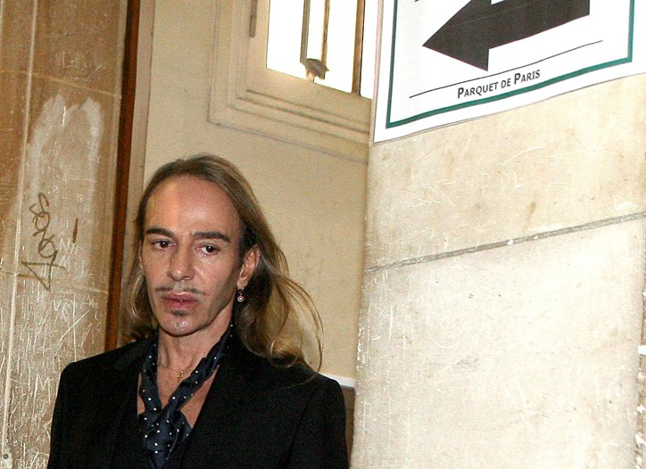 John Galliano arrives at court in Paris.