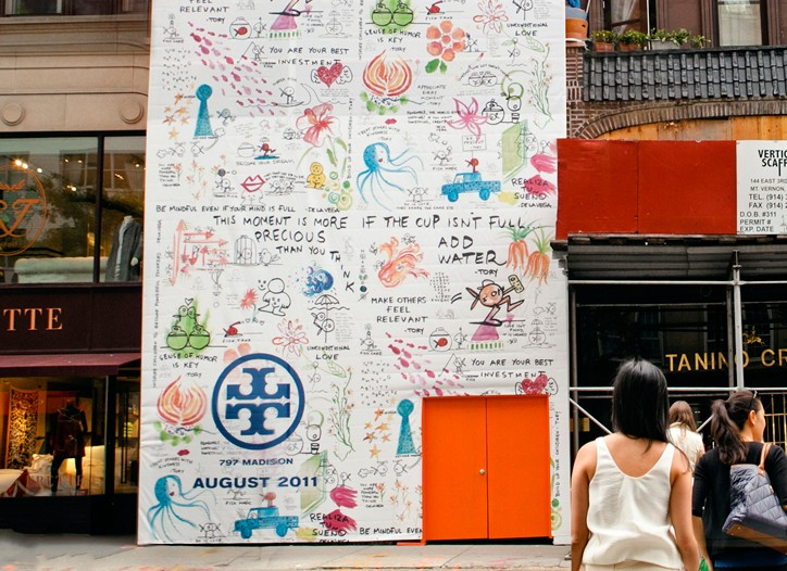 The hoarding, which went up Thursday, showcases Tory Burch's collaboration with street artist James De La Vega.