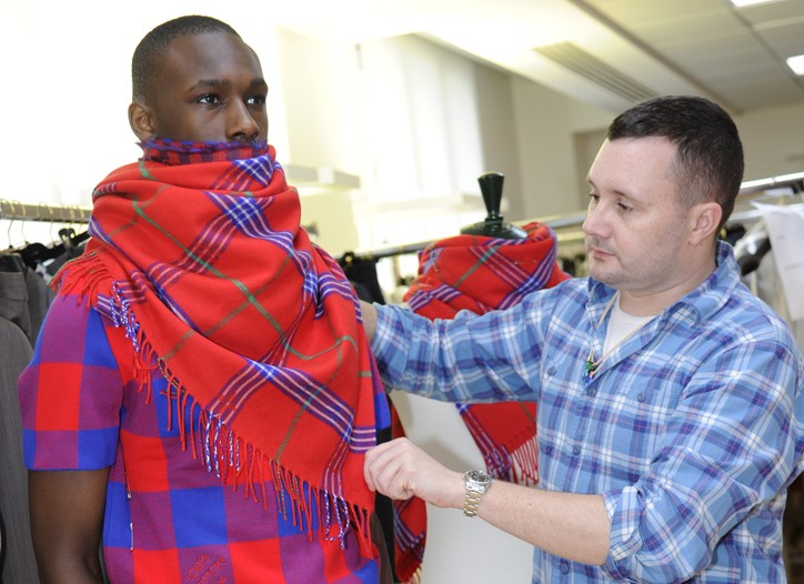 Kim Jones adjusts a look inspired by Masai blankets at Louis Vuitton.