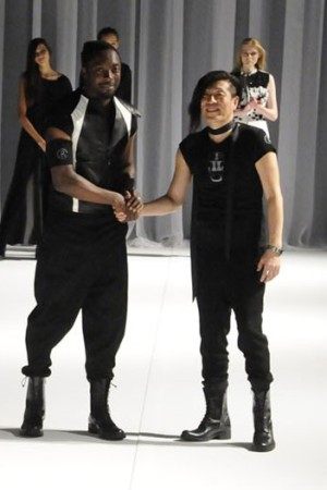 Will.i.am and designer Rynshu on the catwalk