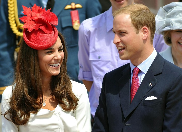 The Duchess of Cambridge in a Reiss Nanette dress and a Anya Hindmarch clutch with the Duke of Cambridge.