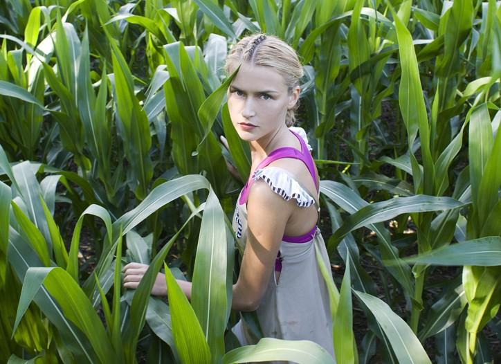 Ari Dein's silk chemise over Puma Body Train's poly-liquid titanium and spandex sports bra.