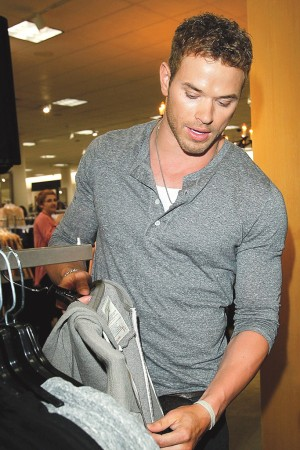Kellan Lutz explaining the details on an Abbot + Main hoodie.