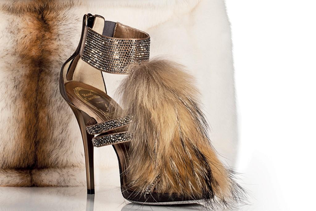 Fendi's mink and cotton Peekaboo handbag, $11,590; René Caovilla's Murmansky fur and Swarovski crystal sandal, $1,410.