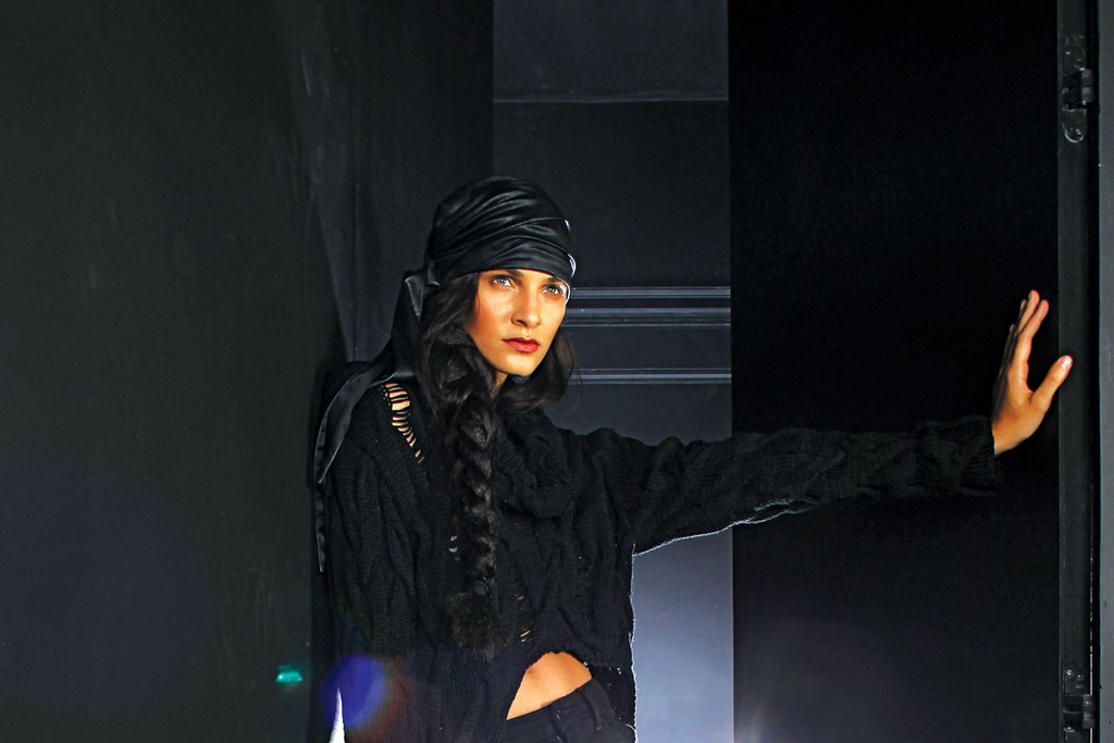 Joe's Black Collection, whose cotton and rayon pair with slashes. Kimberly Ovitz's viscose and sweater. Eugenia Kim turban; Raven Kaufman Couture clutch; Camilla Skovgaard boots.
