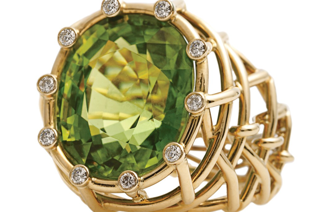 Verdura's 18-karat gold, peridot and diamond ring.