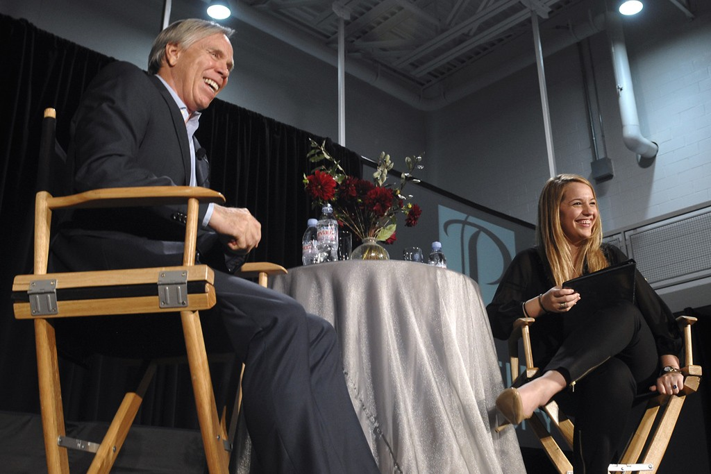 Tommy Hilfiger is interviewed by senior Casey Lamke, president of the student group Fashion Industries Association.