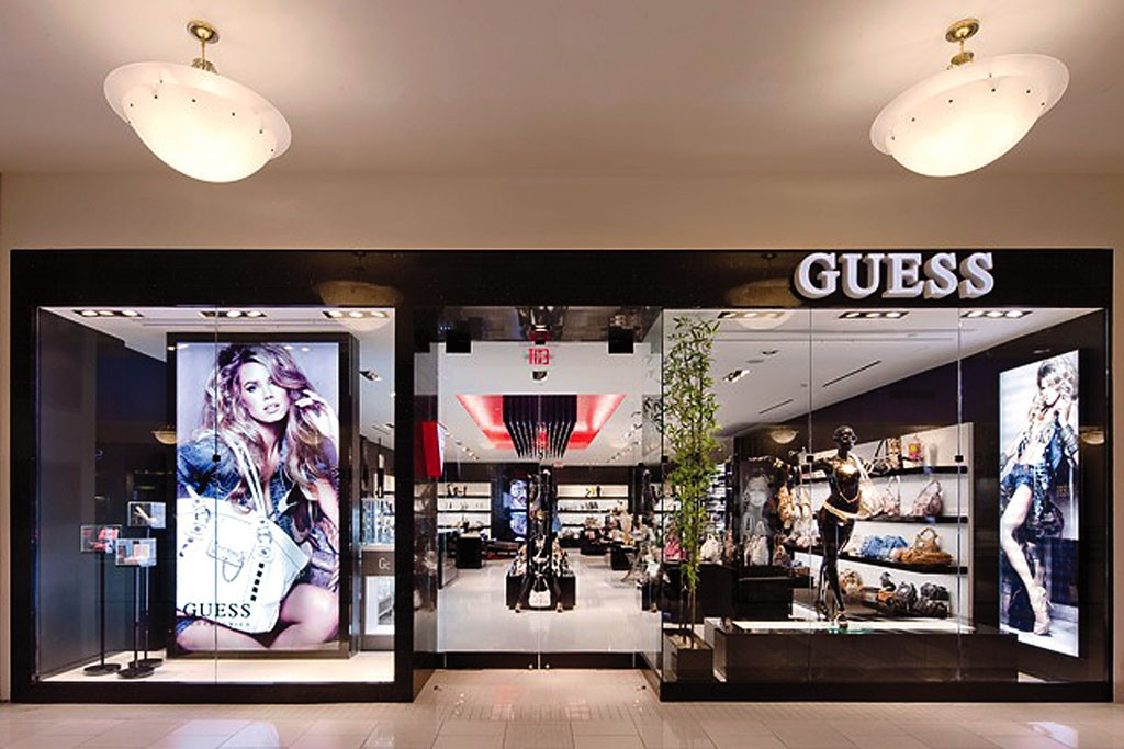 The exterior and entrance of a Guess store.