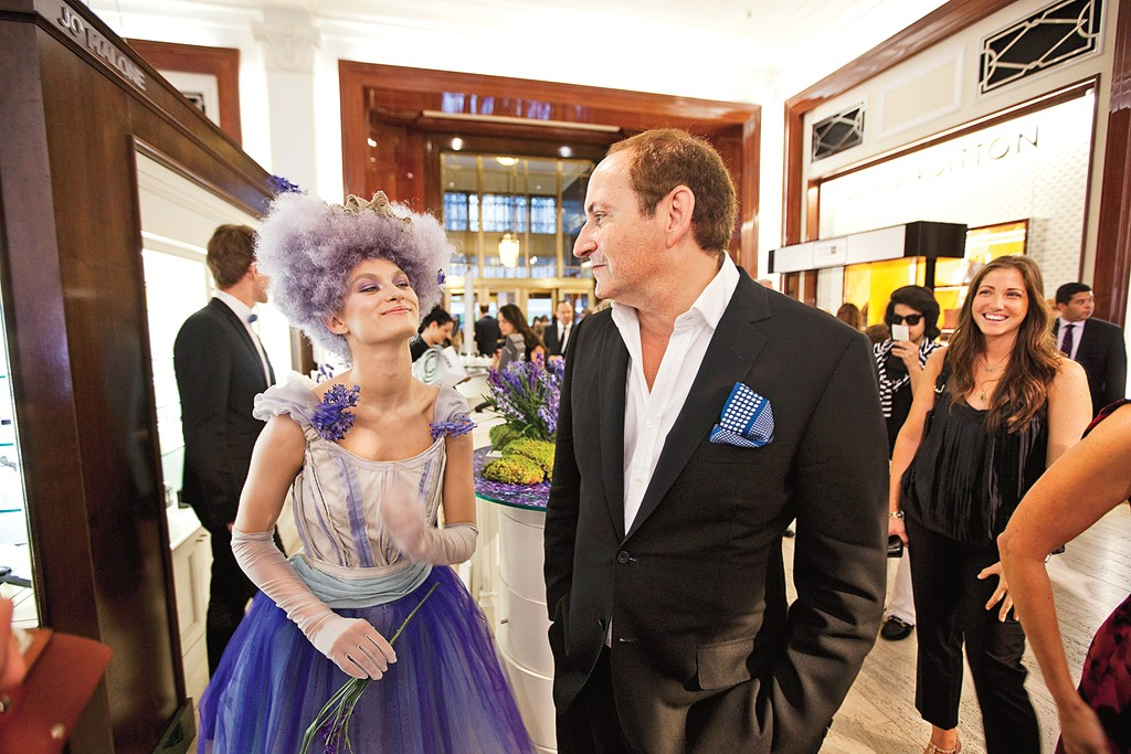 Demsey starts Fashion's Night Out at Saks Fifth Avenue, where his first encounter is with a model dressed up for Jo Malone's Wild Bluebell scent.