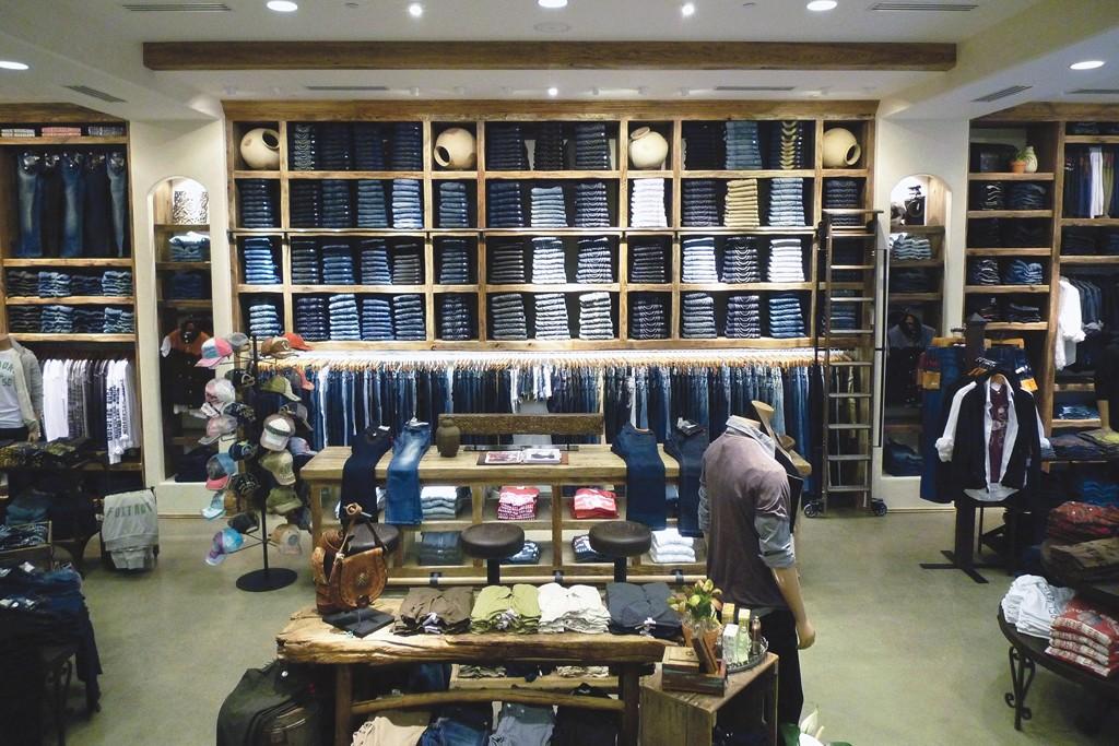 The interior of a True Religion store.