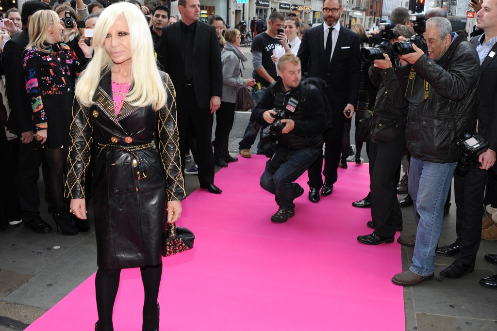 Donatella Versace on the pink carpet outside H&M.