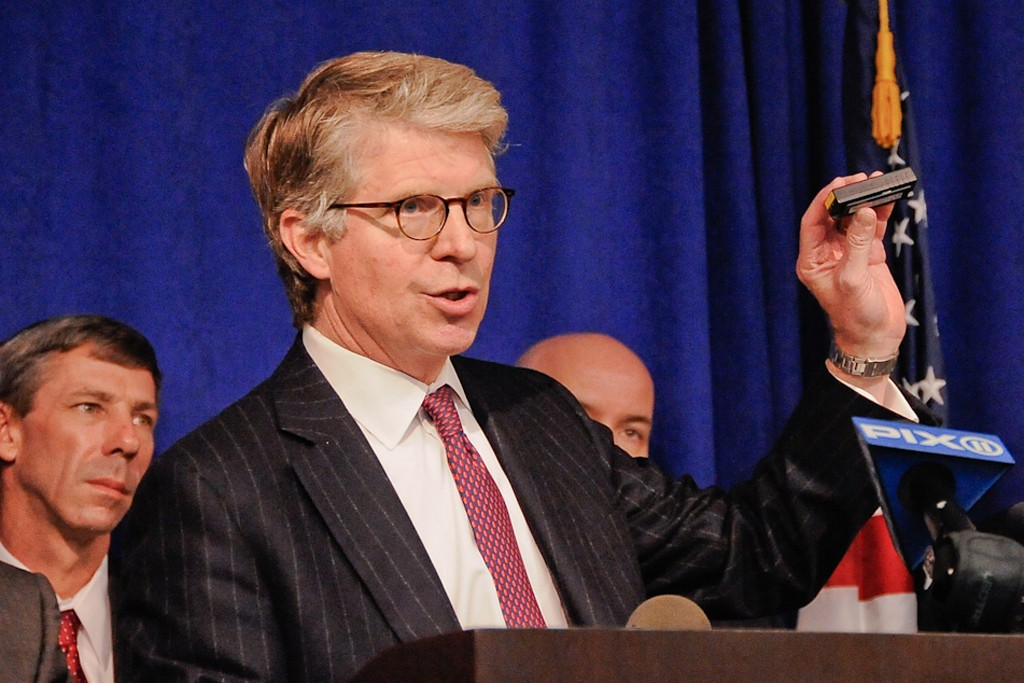 """Manhattan district attorney Cyrus Vance with a """"skimmer"""" electronic device that copies credit card information."""