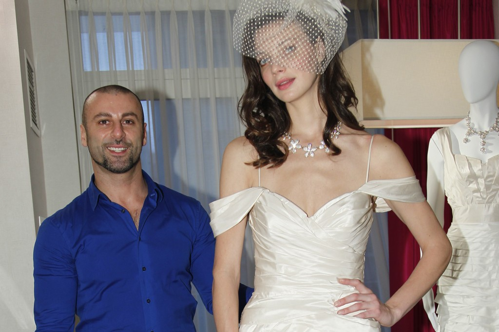 Rami Kashou signature draped silk taffeta wedding gown with a sweet heart necklace.