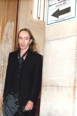 Designer John Galliano arriving to a court date in Paris